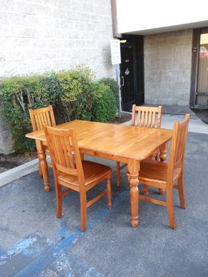 Nice oak wood dining table and chairs for Sale in Fontana, CA
