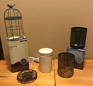 Authentic Silhouette Scentsy Collection including 3 Warmer Metal Wraps & Warmer Stand. for Sale in Miami, FL