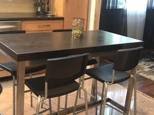 Black table with 4 bar stools for Sale in South Brunswick Township, NJ