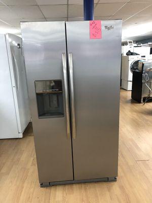 Whirlpool stainless steel side by side refrigerator for Sale in Woodbridge, VA