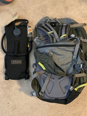 Barely used REI traveler hiking traveler backpack w brand new camel water bladder for Sale in Graham, WA