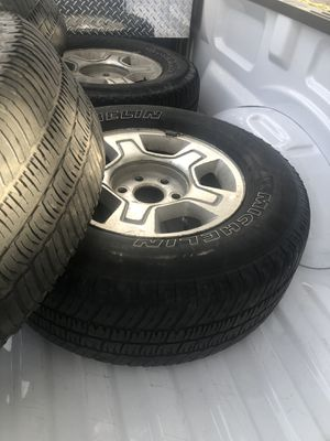 4 rims and tires -used Chevy hub cap covers and lug nuts included for Sale in Littleton, CO