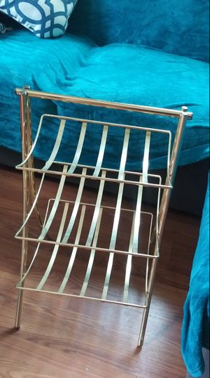 Gold little rack for magazines or towels for Sale in Denver, CO