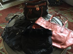 ALL 4 handbags for just $75 only. Brown Micheal Kors, Black Coach, Orange Fossil, last handbag has no name for Sale in Los Angeles, CA