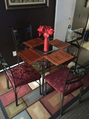 Glass table with 4 chairs for Sale in Raleigh, NC