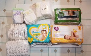180 newborn diapers (sizes 1 and 2) for Sale in Buffalo, NY