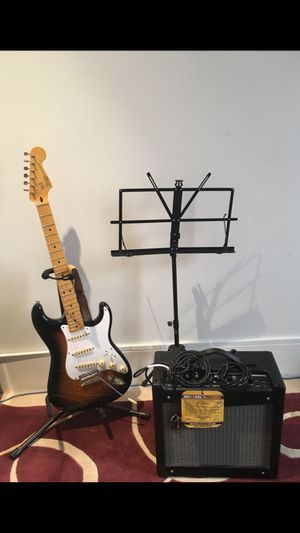 Fender electric guitar with fender amp and music stand - Squire Stratocaster. NEED GONE for Sale in Portland, OR