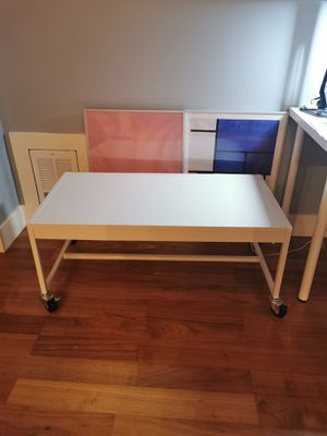 Metal white coffee table with locking casters for Sale in Seattle, WA