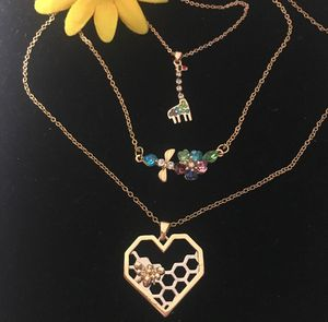 Bee giraffe and dragon fly Necklaces. for Sale in Denver, CO