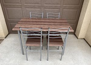 5 pcs Metal Dining Table and Chairs Set for Sale in Bakersfield, CA
