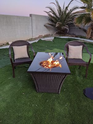 """Patio wicker fire pit and 2 wicker chairs good condition 28"""" wide x 48""""long x 23"""" high for Sale in North Las Vegas, NV"""