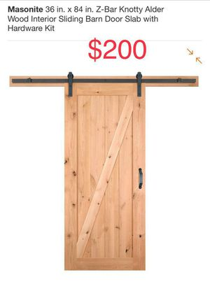 """Masonite 36"""" x 84"""" Knotty Alder Wood sliding door with hardware kit for Sale in Bakersfield, CA"""