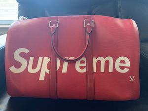 Used Louis Vuitton supreme duffle bag for Sale in Dallas, TX