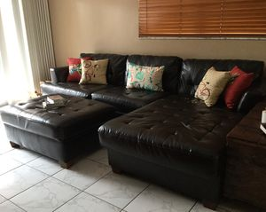 Black sectional sofa with ottoman. Decorative pillows are not included there 3 sofa pieces one of the pieces is damaged for Sale in Hialeah, FL