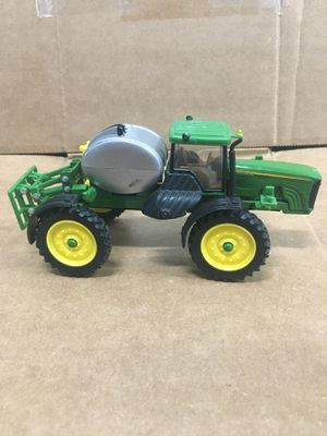 Ertyl small metal John deer tractor sprayer with tank for Sale in Portland, OR