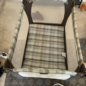 Graco Pack 'N Play Brown And Blue Plaid for Sale in Mission Viejo, CA