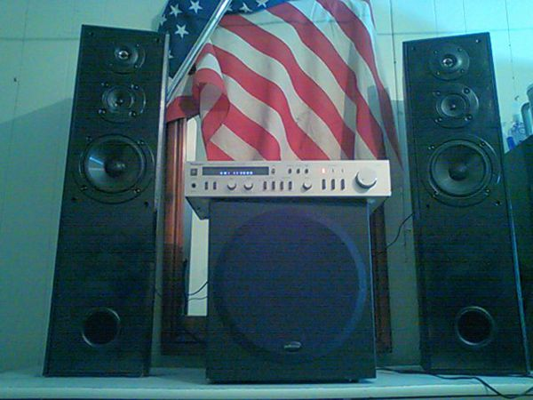Technics stereo integrated Amplifier ,two sony tower speakers and a 12 inch Polk audio sub