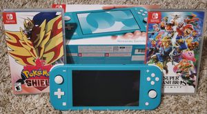 Brand New Nintendo Switch Lite Turquoise, comes with Pokemon Shield, Super Smash Bros. Ultimate, and 128 GB Micro SD Card for Sale in Port Richey, FL