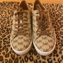 Authentic Michael Kors Beige Mk Monogram Sneakers 6.5 for Sale in Visalia,  CA
