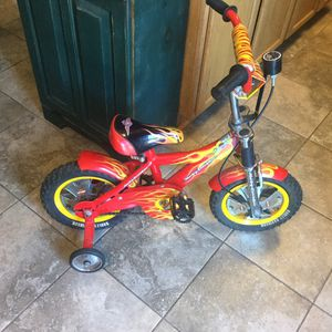 """Harley-Davidson-Kids-Bicycle-Red-And-Yellow-Flames like new tires, HARLEY Davidson marking throughout. This is a size 12"""" bike. It has HARLEY traini for Sale in Plainfield, IL"""