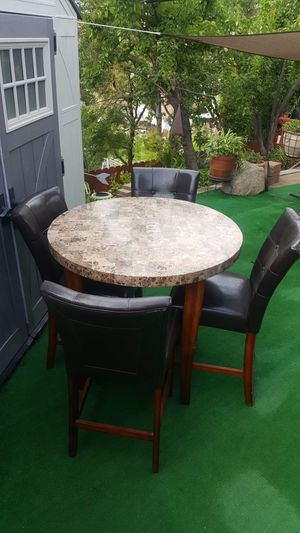 BEAUTIFUL TALL MARBLE TOP TABLE & (4)DARK GREY LEATHER CHAIRS for Sale in Oakdale, CA