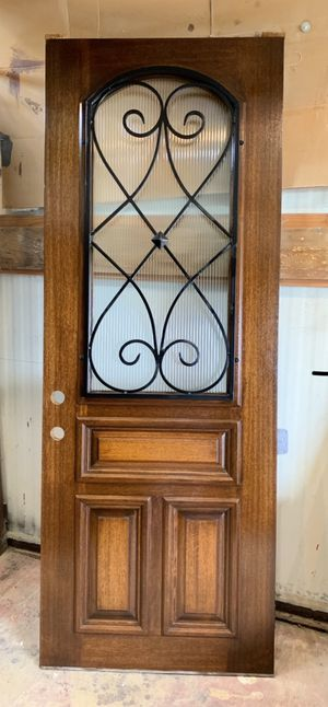 NEW front door with beautiful rough iron design and opaque rippled glass. $ 750 solid wood door, 36 by 96, 3 foot by 8 foot. No installs, only selli for Sale in Irving, TX