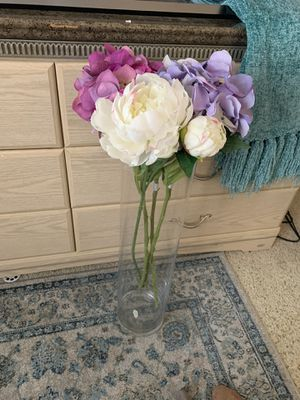 Long glass vase with flowers purple and white for Sale in Las Vegas, NV