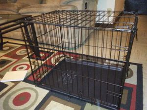 Med. Size fold up Dog Cage like new asking 20$ firm 2 foot long 1/ 1/2 in height for Sale in Stockton, CA