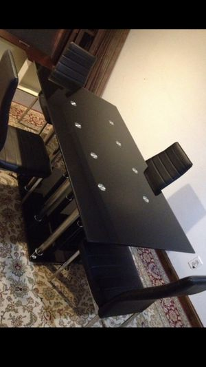 Black color Tempered glass dining table with 4 leather chairs for Sale in Woodbridge, VA