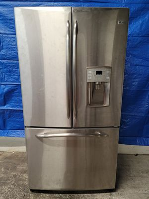 GE counter depth stainless steel fridge good working conditions *water those not work but fridge and freezer are working good for Sale in Denver, CO