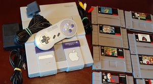 Super Nintendo system with 8 games for Sale in Fresno, CA
