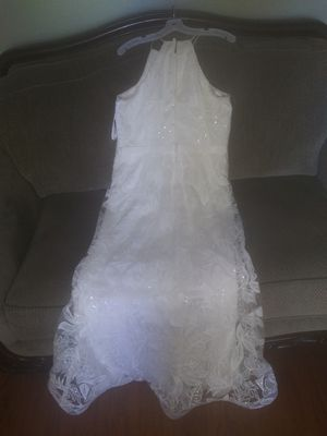 Beautiful sheer lace wedding dress from Davids Bridal, size 10. for Sale in Gulfport, FL