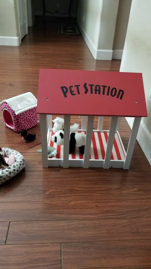 Wooden pet station with assorted justice dog items for Sale in Sarasota, FL