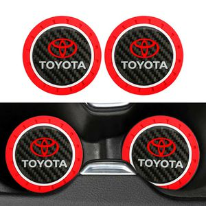 BRAND NEW 2PCS TOYOTA RED RUBBER CUP MAT WITH REAL CARBON FIBER EMBLEM for Sale in City of Industry, CA