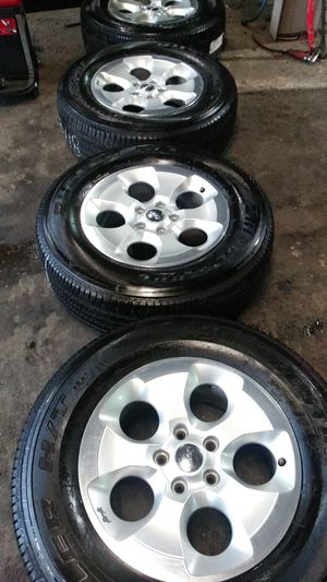 2018 jeep wrangler wheels 255/70/18 Bridgestone Dueler HT tires basically new mounted and balanced ready to go! for Sale in Tacoma, WA