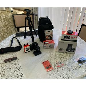 Canon EOS Rebel SL2 DSLR. Wi-for camera with EF-S 18-55 mm. STM LENS. With flash, plus lenses, filters, 32 go, backpack, Xpix tripod and cleaning kit for Sale in Miami, FL