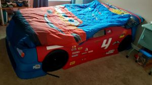 Cars bed with dresser and night table no mattres and toys for Sale in Kissimmee, FL