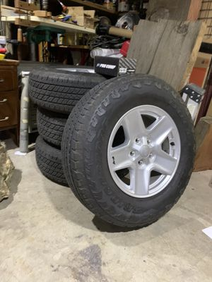 Four like new Jeep Bridgestone tires and wheels plus a spare for Sale in Spring Valley, CA