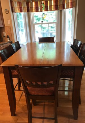 Extendable Counter height table with 6 chairs. Solid wood for Sale in Fairfax, VA