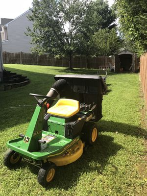 John Deere, W/two Xtra large grass collectors. Excellent running condition! for Sale in Bristow, VA