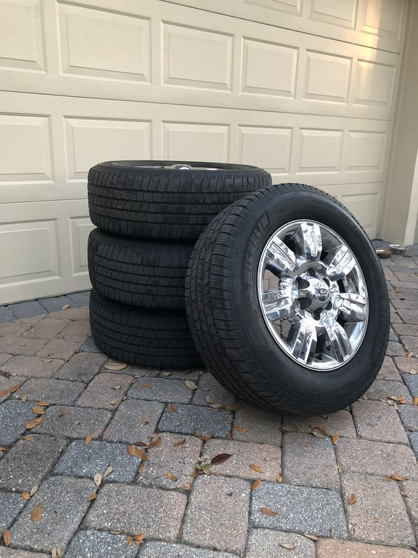 Ford F-150 wheel and tire package. Chrome rims, 265/60r18 tires, comes with bolts.