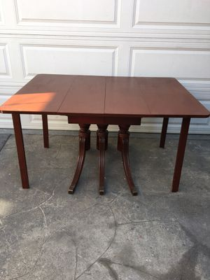 Antique foldable dining table with two extension leafy for Sale in Long Beach, CA