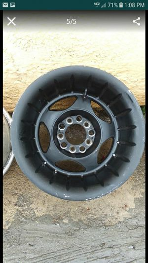"BLACK RIMS SIZE 15"" WITH 3 GOOD TIRES SIZE 33/.UNIVERSAL 10 HOLE FITS CHEVY / FORD/CHEROKEE NO DENTS AND NO BENDS. for Sale in Paramount, CA"
