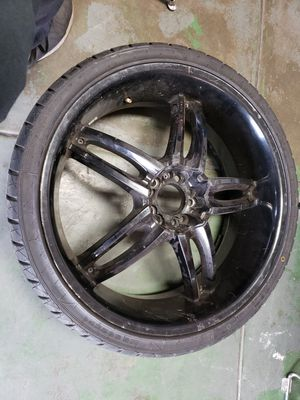 265/30zr22 tire and rim for Sale in Aurora, CO
