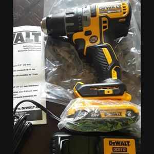 Brand new Dewalt 20v Xr Brushless Drill battery And Charger for Sale in Fresno, CA