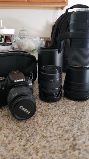 Canon camera with Tamron brand extra extending lenses and back pack bundle for Sale in San Diego, CA