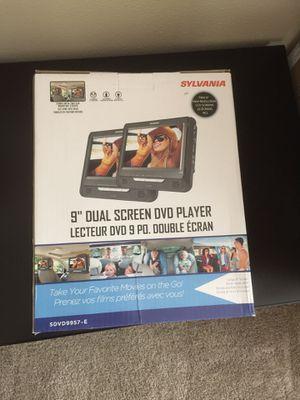 "New in box 9"" dual screen DVD player for Sale in Redmond, WA"