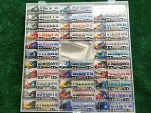 1999 Whiterose Collectible NFL Trucks and Display case for Sale in Sun City, AZ