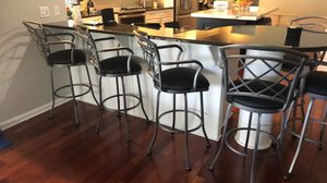 4 swivel 30 inch seat bar height bar stools with arms. New never been used still in boxes. for Sale in Tampa, FL