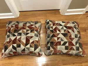 Set of 2 Couch Throw Decorative Pillows in red, orange, tan and brown tones in fair condition , $5 for both. Pickup in Apex for Sale in Apex, NC